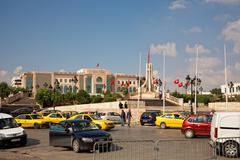 heavy traffic close to city hall of tunis, tunisia - stock photo