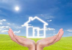 house icon on hand - stock photo