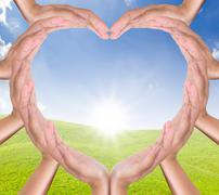 Hands heart on new day Stock Photos