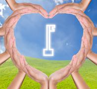 key icon in hands heart - stock photo