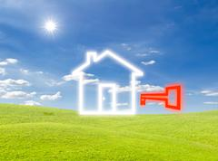 Key of house icon on green grass meadow Stock Photos