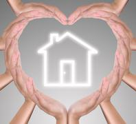 house icon in heart hand - stock photo