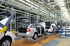assembling cars on conveyor line - stock photo