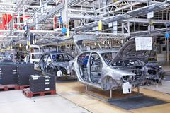 Assembling cars skoda octavia on conveyor line Stock Photos