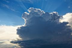Cloudscape and sunbeams before thunderstorm Stock Photos