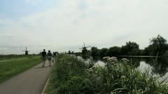 Netherlands Kinderdijk walking toward several windmills 5 Stock Footage
