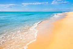Sand beach water background Stock Photos