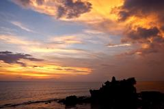 Sunset over hindu temple tanah lot, bali Stock Photos