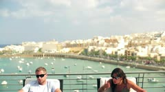 Young couple arguing on the terrace, crane shot Stock Footage
