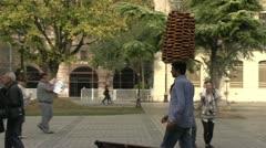Odd sight, bread head man walking through square Stock Footage