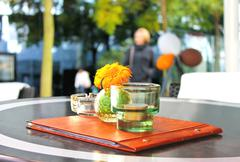 Flower,  menu and  candle on  table in  cafe. Stock Photos