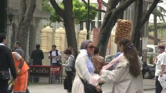 Odd man, bread head man walking through square Stock Footage