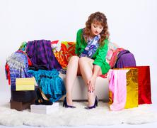 Shopaholic woman with purchases Stock Photos