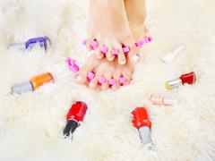 Feet in toe separators Stock Photos