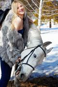 beautiful girl with horse - stock photo