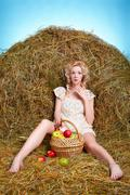 country girl on hay - stock photo