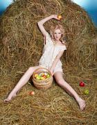 Stock Photo of country girl on hay