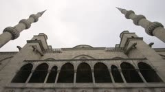 History & culture, Sultan Ahmed Mosque, Blue mosque square and minaret tilt down Stock Footage