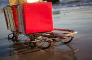 Christmas gifts on a sled on the beach in Malibu Stock Photos