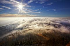 View on the sun over inversion from jested, jested-kozakov ridge, czech repub Stock Photos