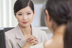 Stock Photo of asian chinese woman or businesswoman in meeting