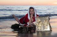 Attractive woman in Santa Claus costume Stock Photos