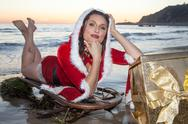 Attractive woman in Santa Claus costume Stock Photos