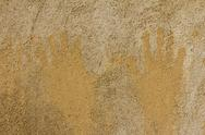 Stock Photo of prints of children's hands on a background of concrete