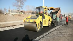 Asphalt concrete laying with Road roller - stock footage