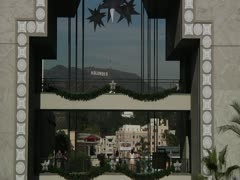 Zoom out from Hollywood sign into Kodak mall day 5 Stock Footage