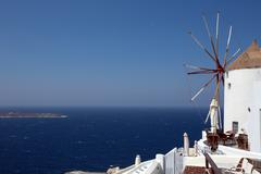 Windmil looking out to sea, santorini. Stock Photos