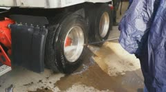 Power washing tire Tractor Trailer - stock footage