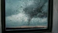 Tornado breaking window glass with flying debris. Stock Footage
