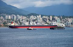 n. vancouver a tanker & tug boat in burrard inlet ca. - stock photo