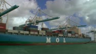 Cargo ship at loading docks at Port of Miami Stock Footage