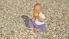 Baby playing with apple Stock Footage