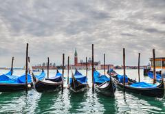 Gondolas floating in the grand canal Stock Photos