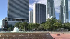 Birds play in water of Fountain at Bayfront park in Miami. Stock Footage