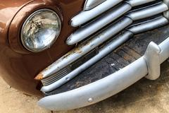 oldtimer front grill and headlamp details - stock photo