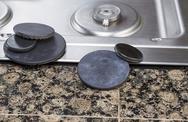 Stock Photo of stove burner covers maintenance