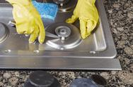 Stock Photo of cleaning natural gas stove burner