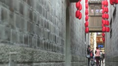 Chengdu, China, a ancient alley, top of the brick wall hanging red lantern. Stock Footage