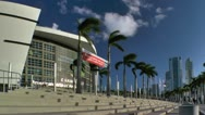 Stock Video Footage of Jogger runs down front steps of American Airlines arena in Miami.