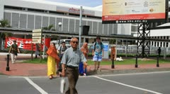 Malaysian walking on pedestrian crossing Stock Footage