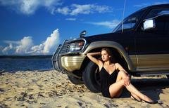 girl and off-road car - stock photo