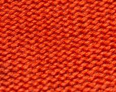 Red knitted fabric as background Stock Photos