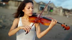 Violinist on the beach Stock Footage