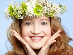 Happy girl with flower crown Stock Photos