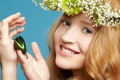 Beautiful girl and butterfly Stock Photos
