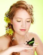 beautiful girl and butterfly - stock photo
